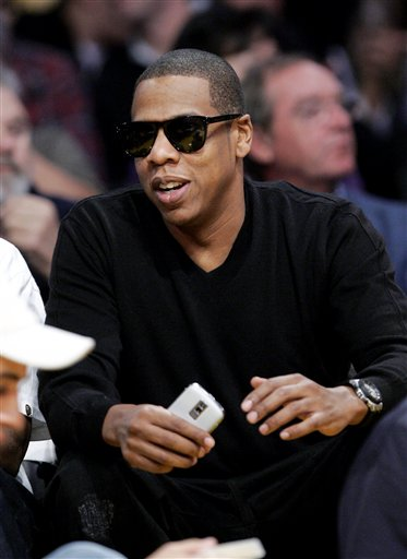 Recording artist Jay-Z watches the New Orleans Hornets-Los Angeles Lakers NBA basketball game in Los Angeles on Sunday, Nov. 8, 2009. The Lakers won 104-88. (AP Photo/Francis Specker)
